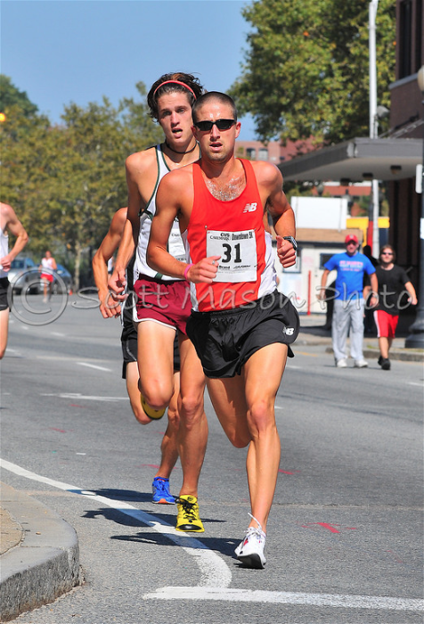Chris lurks over an opponent's shoulder at the CVS 5k back in '08. Damn, we need to get more up to date photos. This one courtesy of Scott Mason Photo.