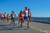 Jenkins leads Sanca (R) at the Lone Gull 10K. Photo by Scott Mason.
